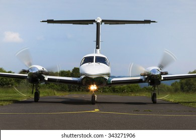 Small private twin-engine piston aircraft on runway