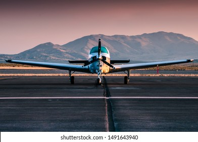Small Propeller plane during moody sunset on the Reno airfield in the desert.