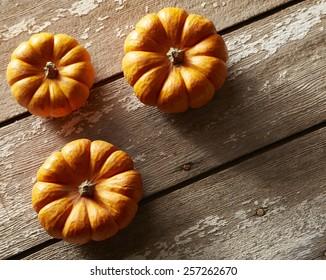 small pumpkins on wood