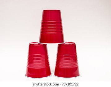 Small pyramid made out of American plastic red cups.
