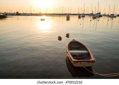 Small recreational boat moored in Colonia del Sacramento marina, Uruguay