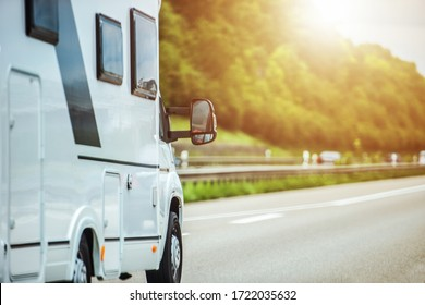 Small Recreational Vehicle Riding On Highway During Summer Time.