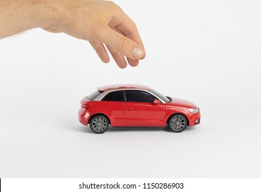 Small red car with man hand
