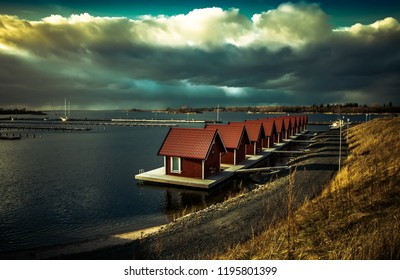 small red fishing cabins on the Swedish east coast just before a thunderstorm