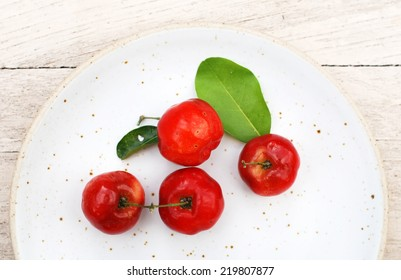 Small red fruit . Brazilian Acerola Fruit . small cherry