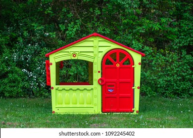 a small red and green plastic child's house