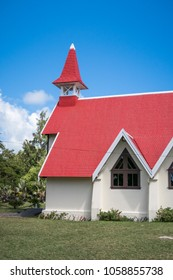 Small red roof Notre Dame Auxiliatrice church at Cap Malheureux beach, Mauritius island
