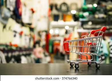 Small Red Shopping Cart In Clothing Store : Filtered Process