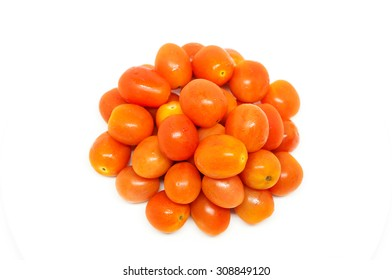 Small red tomatoes on a white background.