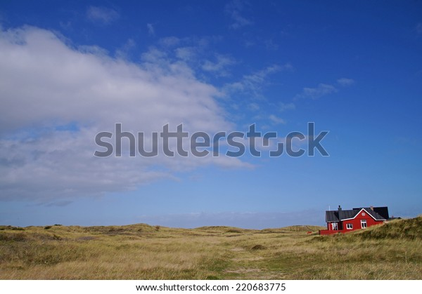 A small red traditional old Danish Holiday home on the Island of Romo in Jutland close to the Wadden Sea