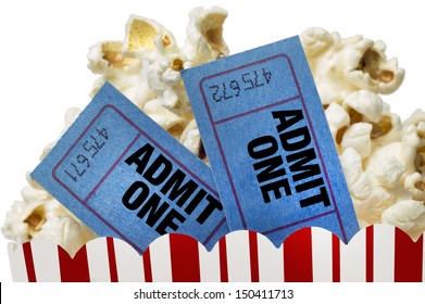 Small Red and White Bucket Of Popcorn With Two Blue Movie Tickets/ Movie Night Close Up On White