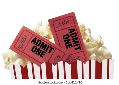Small Red and White Bucket Of Popcorn With Two Red Movie Tickets/ Movie Night Close Up On White