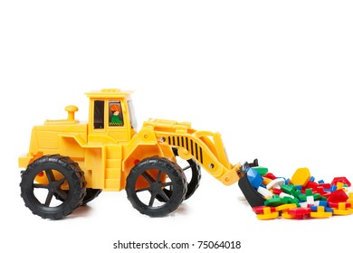 A small replica of an excavator isolated over white background.