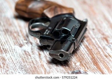small revolver lying on a  table