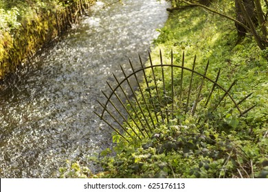 Small river with circular shut-off grid