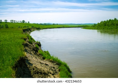 Small river in the green fields of Altai