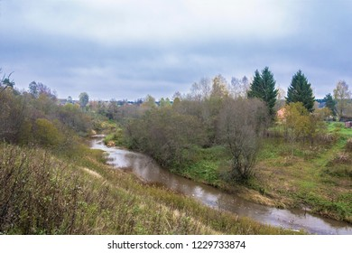 A small river Ukhtom in the village Kukoboya on a dull autumn day, Yaroslavl Region, Russia.