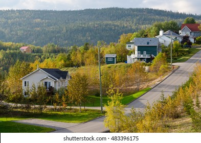 A small road going uphill in town Tadoussac, Quebec
