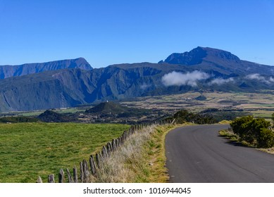 Small road with Piton des neiges mountain in background in la Reunion island, a french overseas department in the Indian Ocean