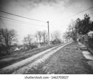 small road in a rural area, this black and white camera obscura photo is NOT sharp due to camera characteristic. Taken on analogue photographic large format negative film with a pinhole camera