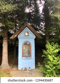 A small roadside chapel with a religious icon in the city of Rzeszow, Poland.