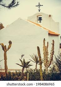 Small roadside chapel in Santa Pola near Alicante, Spain - Shutterstock ID 1984086965