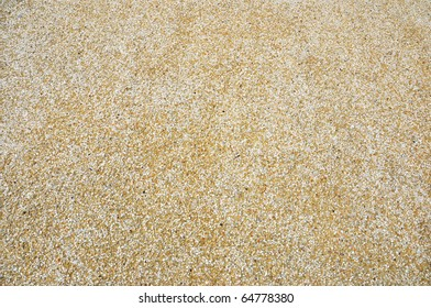 small rocks and fine stone in the yellow cement