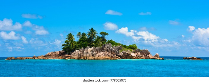 Small rocky Island in the Indian ocean near Seychelles. Long wide banner