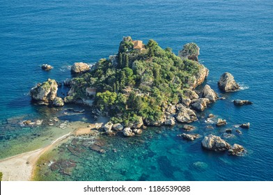 Small rocky island surrounded by blue waters off shores of Europe (Greece).
