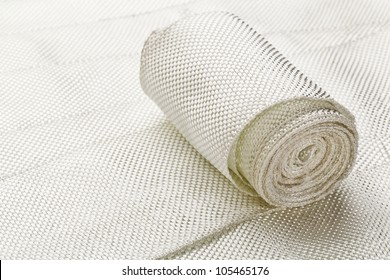 a small roll of fiberglass cloth tape made of twisted strands of fiberglass with woven edges