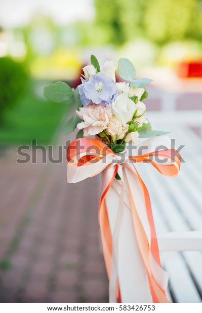 Small roses buds in tenderless boutonniere, closeup