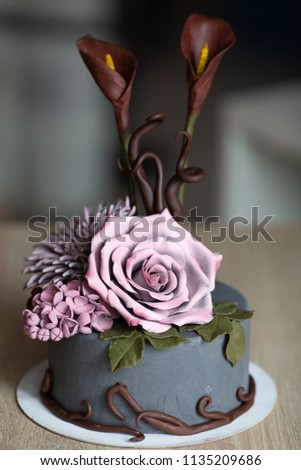 Small Round Birthday Cake With Edible Pink Chocolate Flowers Isolated