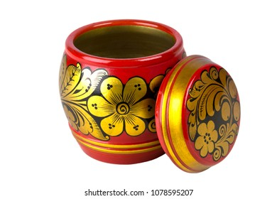 Small round box with lid removed, painted in Khokhloma style. Closeup. Isolated on white.