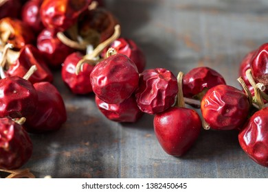 Small round red chilly peppers.