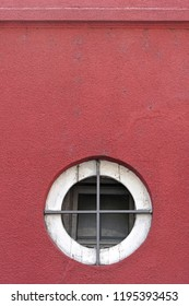 Small round window with security bars cross