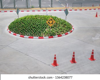 Small Roundabout with Traffic Symbols and Road Cones