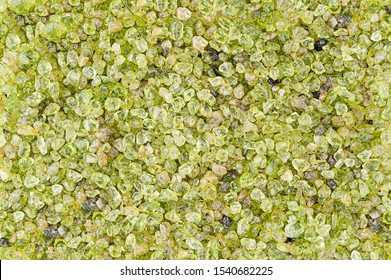 Small rounded green peridot stones textured background