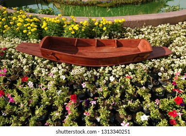 small rowing boat on colorful flowers background.
