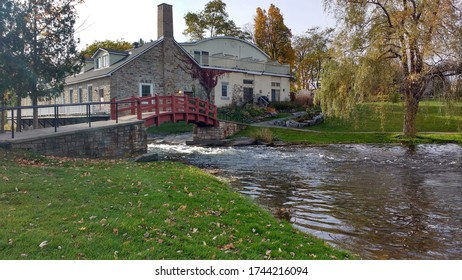 Small rural farm home beside a river in an agricultural area