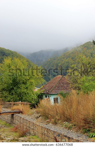 small-rural-house-romania-misty-600w-636