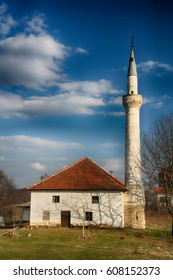 Small, rural mosque with one minaret, spring