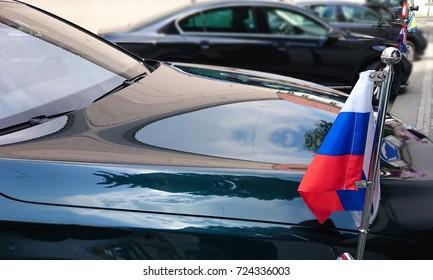 small Russian Federation flag at the Russian diplomatic luxury black car. diplomat of Russia. flag of Bosnia and Herzegovina, Croatia