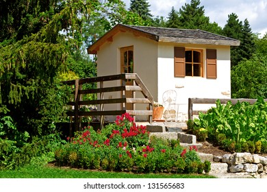 Small rustic swiss cottage and garden