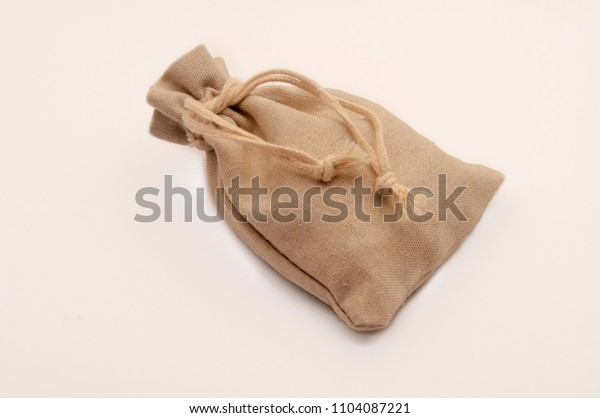 Small sack of closed fabric isolated  on white background