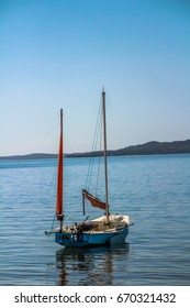 Small sail boat on the water