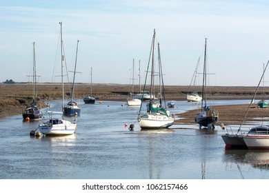 Small sail boats moored at high tide on the North Norfolk coast.