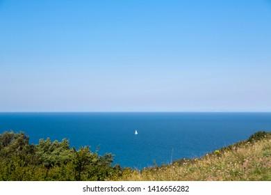 small sailboat on the baltic sea, HIddensee Island Germany