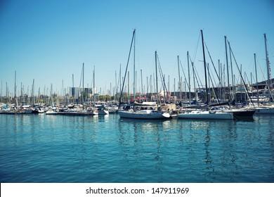 Small sailboats in a Barcelona harbor