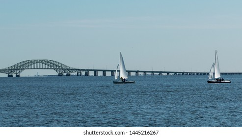 Small sailbots enjoing a beautiful day in the great south bay with the Robert Mosses bridge in the background,