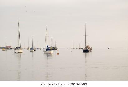 Small sailing boats anchored at high tide